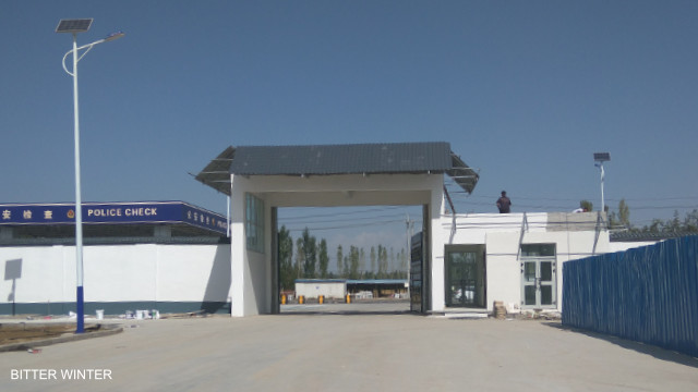 """Welcome to """"freedom"""": entering the area of the Yining camp where inmates should work in six factories."""
